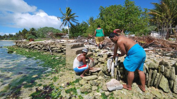 Residents of Kiribati piling stones and sandbags to stave off rising ocean waters, from January 2015